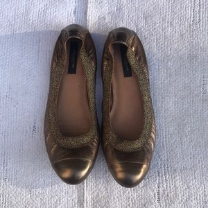 Flats that are bronze/gold with glittering detail